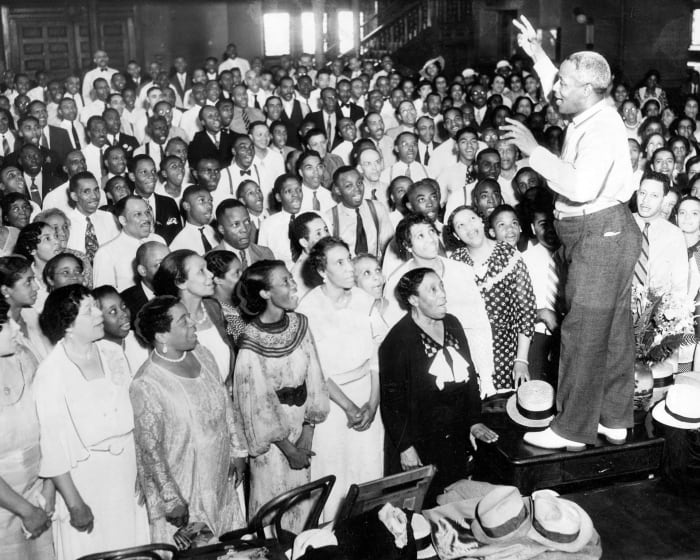 J. Wesley Jones, choir director, directs 600 black singers during a rehearsal in Chicago, August 1935. The group rehearsed for the next Chicagoland Music Festival where they would sing