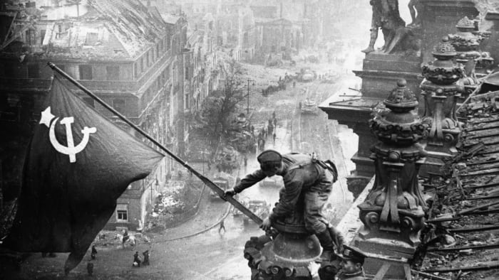 Soldiers of the Red Army raise the Soviet flag on the Reichstag in Berlin, May 2, 1945.