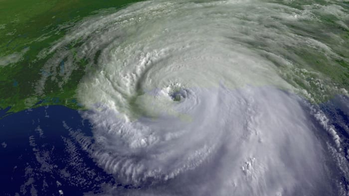 In this satellite image, a close-up of the center of rotation of Hurricane Katrina is seen at 9:45 a.m. EST on August 29, 2005 over southeastern Louisiana. Katrina made landfall that morning as a Category 4 storm with sustained winds over 135 mph.
