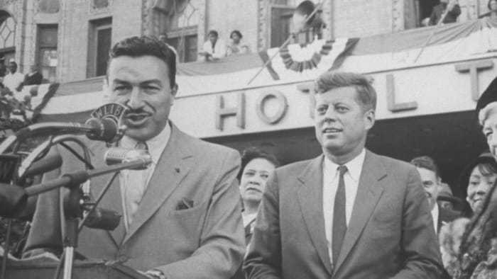 Democratic Representative Adam Clayton Powell introduces Democratic Party presidential candidate John Kennedy outside the Theresa Hotel in Harlem during his election tour.