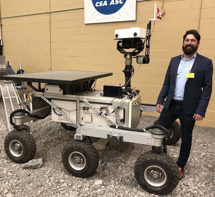 Christopher Hamilton pictured next to rover at Canadian Space Agency.