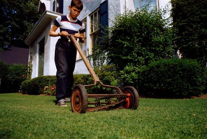 boy mowing the lawn