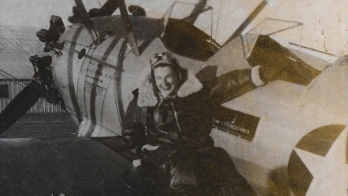Jane Tedeschi next to one of the planes she flew in WWII with the Women Airforce Service Pilots (WASP), a group that performed aviation services in the United States, covering deployed male pilots on the front lines of World War II.  She was one of more than 1,100 female pilots who moved planes and towed target planes for live fire exercises.