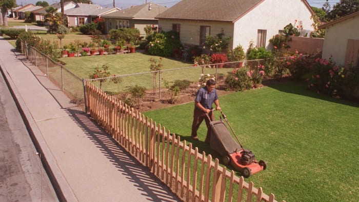 Mowing his well-kept lawn on Hill Street, Jesse Madina has lived in the house for 6 years.