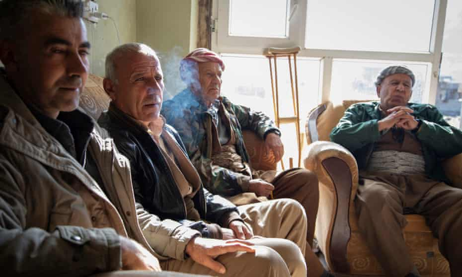 Former Peshmerga (Iraqi Kurdish armed forces) discuss the region's tumultuous history in a social club in Sheladze.