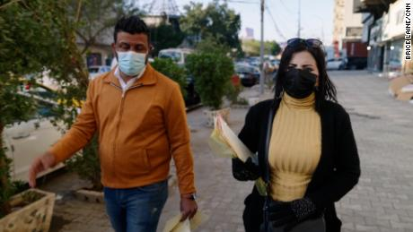 Seeds Kare, right, an anti-drug activist conscience in a neighborhood canvasses fly in the central Baghdad.
