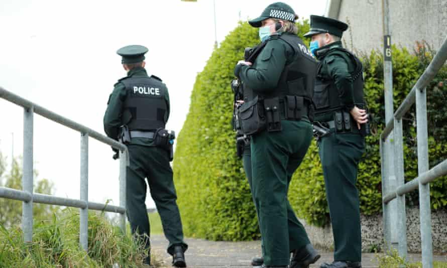 Three police officers patrol on foot