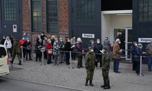 People line up outside a vaccination centre in Berlin on Thursday. Many of them had arrived there in taxis, paid for by the state.