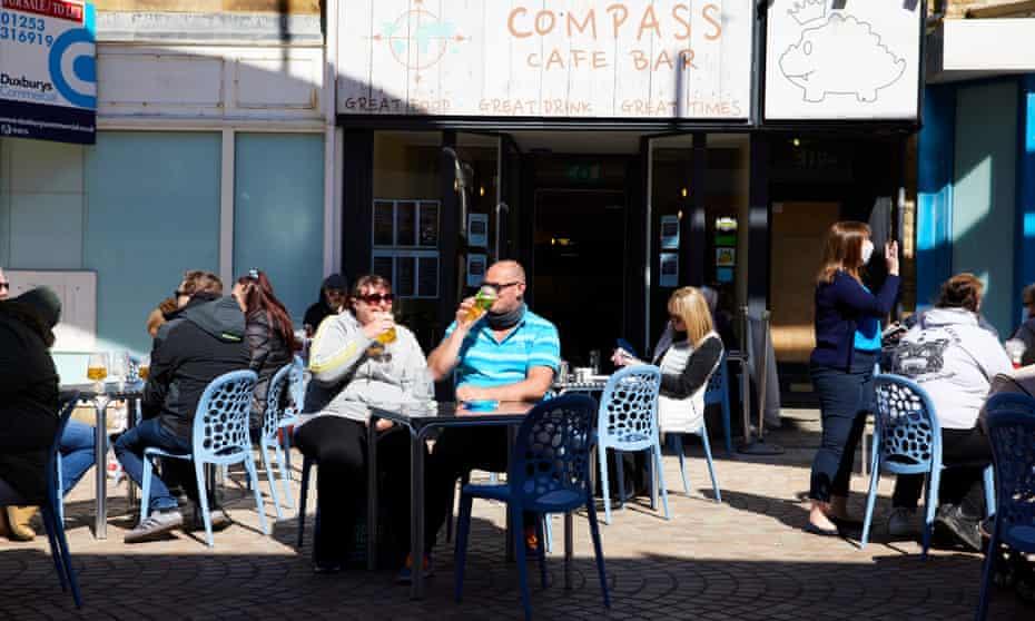 People enjoy drinks outside