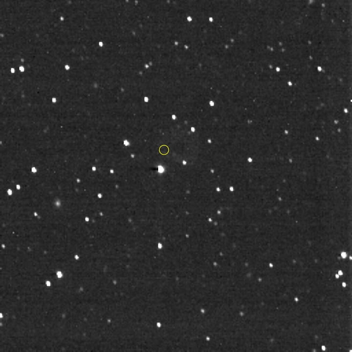 Hello, Voyager! From the distant Kuiper Belt at the solar system's frontier, on Christmas Day, Dec. 25, 2020, NASA's New Horizons spacecraft pointed its Long Range Reconnaissance Imager in the direction of the Voyager 1 spacecraft, whose location is marked with the yellow circle. Voyager 1, the farthest human-made object and first spacecraft to actually leave the solar system, is more than 152 astronomical units (AU) from the Sun—about 14.1 billion miles or 22.9 billion kilometers—and was 11.2 billion miles (18 billion kilometers) from New Horizons when this image was taken. Voyager 1 itself is about 1 trillion times too faint to be visible in this image. Most of the objects in the image are stars, but several of them, with a fuzzy appearance, are distant galaxies. New Horizons reaches the 50 AU mark on April 18, 2021, and will join Voyagers 1 and 2 in interstellar space in the 2040s.