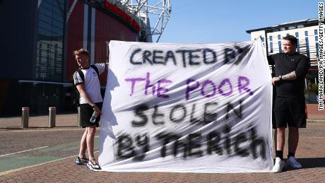 European football fans opposing the outside Old Trafford in Manchester.