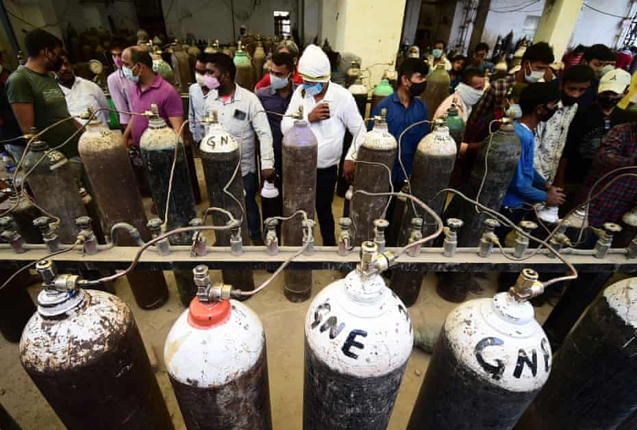 People refill medical oxygen cylinders for Covid-19 coronavirus patients at an oxygen refile station in Allahabad, 20 April