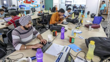 Employees working on laptop computers at Flipkart headquarters in Bengaluru, India.