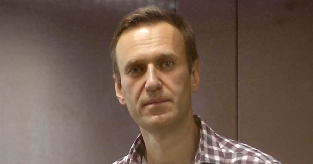 Kremlin critic Alexei Navalny's life 'in the balance,' aide says as he calls for protests