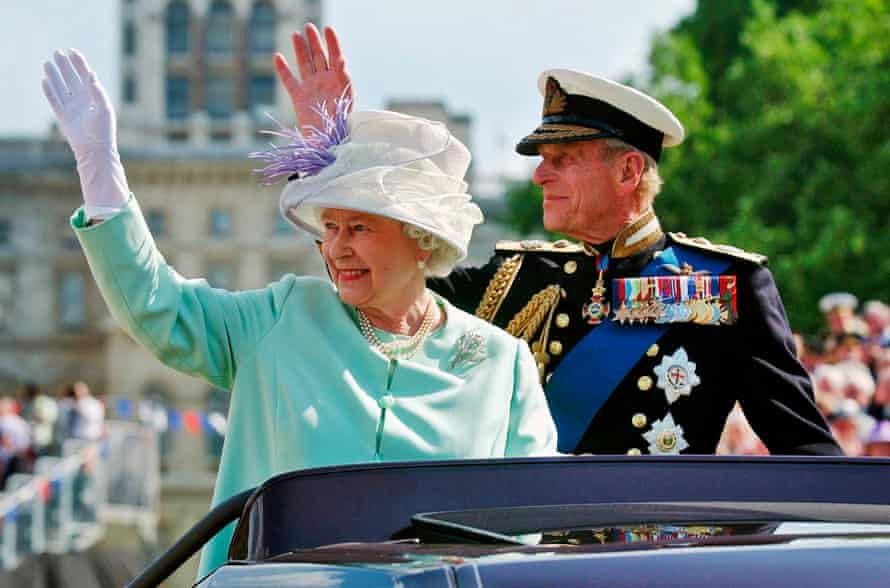 The Queen and Duke of Edinburgh wave to crowds in 2005 as they leave a show marking the end of the second world war.