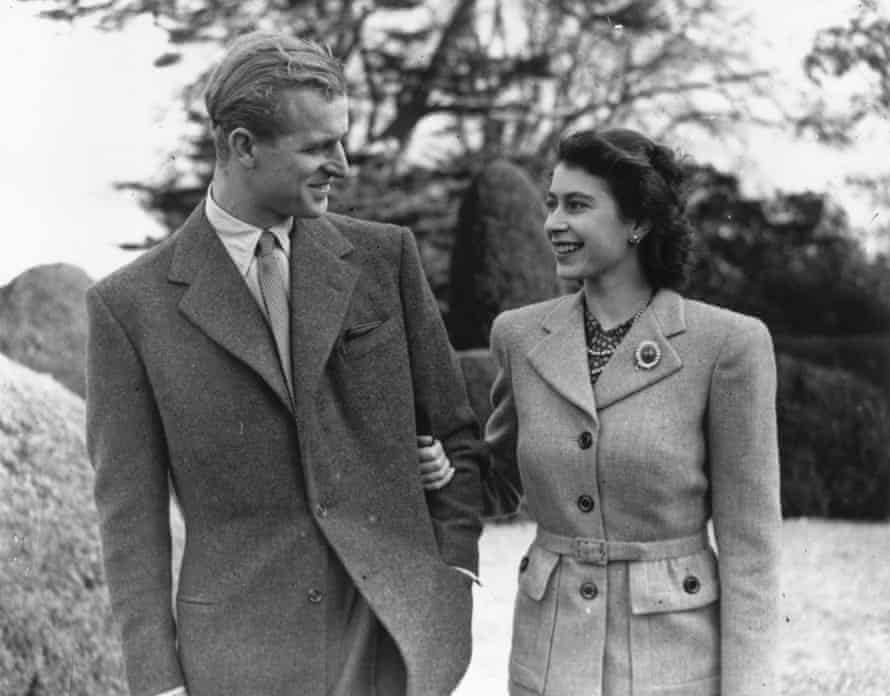 Princess Elizabeth and Prince Philip enjoy a walk during their honeymoon at Broadlands, Hampshire.