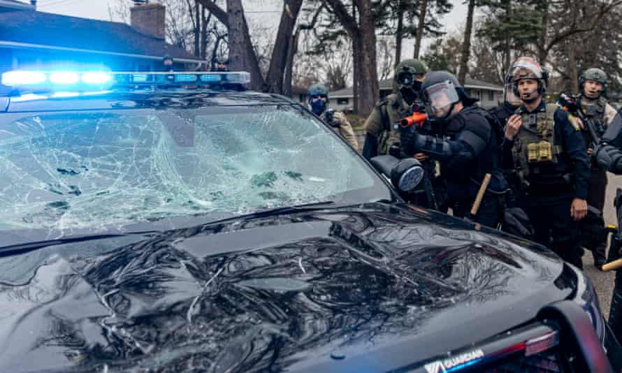 Some protesters damaged police vehicles.