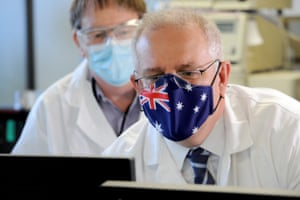 Scott Morrison meets CSL staff working on the Covid AstraZeneca vaccine during a tour of the company's facility in Melbourne on 26 March 2.