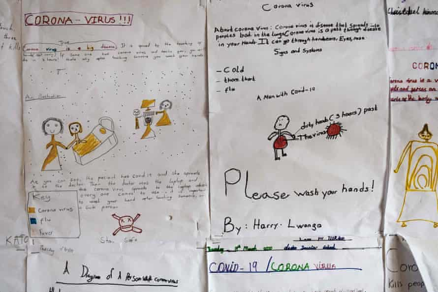 Drawings about coronavirus on the walls of Clarke junior school in Kampala last April. The drawings were made by pupils just before schools closed.