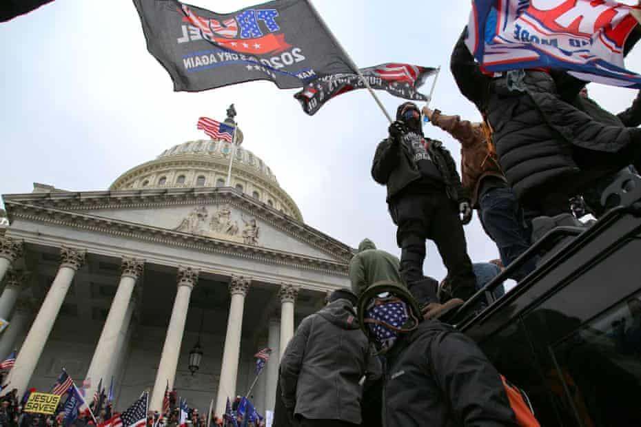 Supporters of Donald Trump surround and storm the US Capitol on 6 January.
