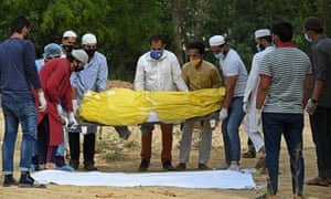 Relatives and friends carry the dead body of a Covid-19victim during a burial in New Delhi earlier in April.