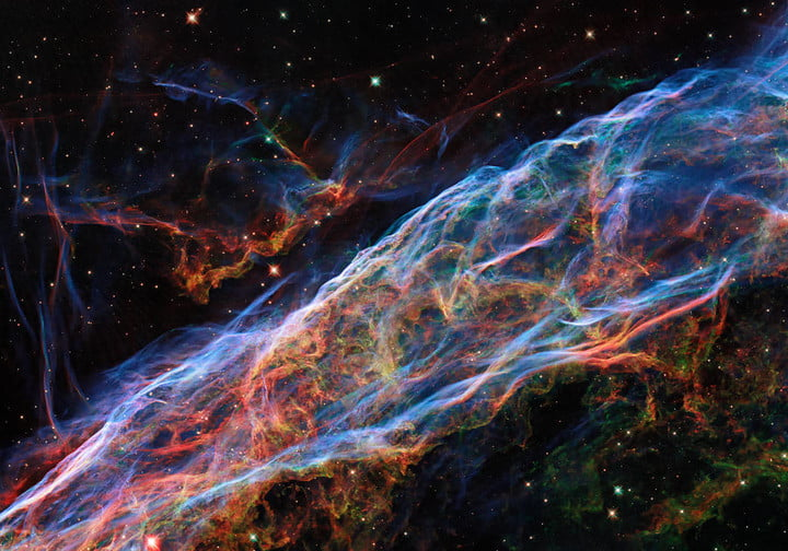 This image taken by the NASA/ESA Hubble Space Telescope revisits the Veil Nebula, which was featured in a previous Hubble image release. In this image, new processing techniques have been applied, bringing out fine details of the nebula's delicate threads and filaments of ionized gas.