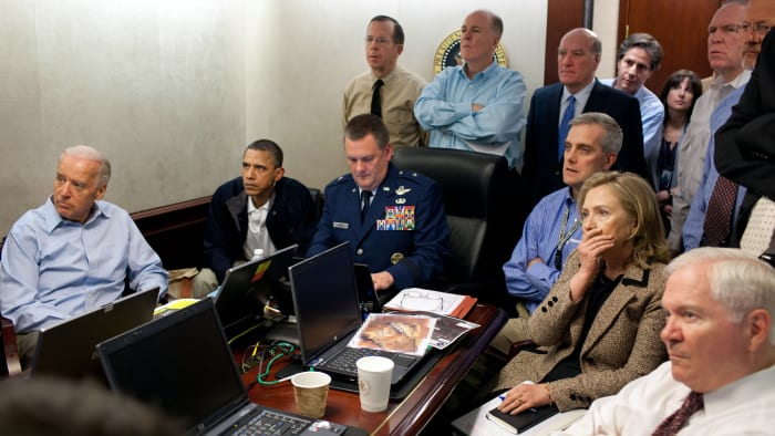 President Barack Obama, Vice President Joe Biden, Secretary of State Hillary Clinton and members of the National Security Team receive an update on the mission against Osama Bin Laden in the White House Situation Room May 1, 2011, Washington, DC