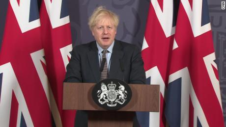 Union banners and surrounded by Boris Johnson