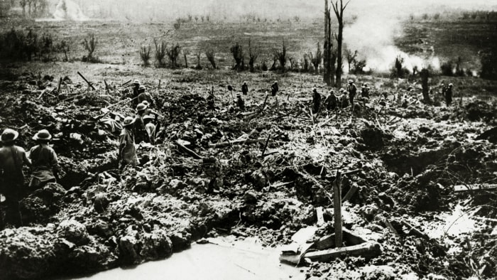 British sappers digging a communication trench towards the Messines ridge in a landscape showing the scars of the battle, May 7, 1917.