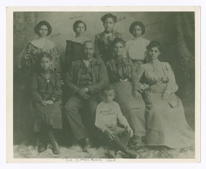 Loula Cotten Williams (third from left) is pictured with her parents and siblings, c. 1902. Later, she moved to Tulsa, Oklahoma, where she and her husband, John Wesley Williams, owned and operated the Dreamland Theater.