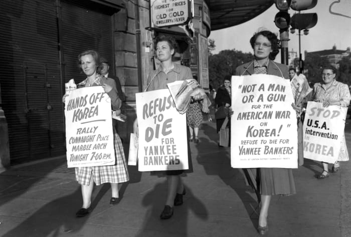 Women with placards demonstrating against the Korean War
