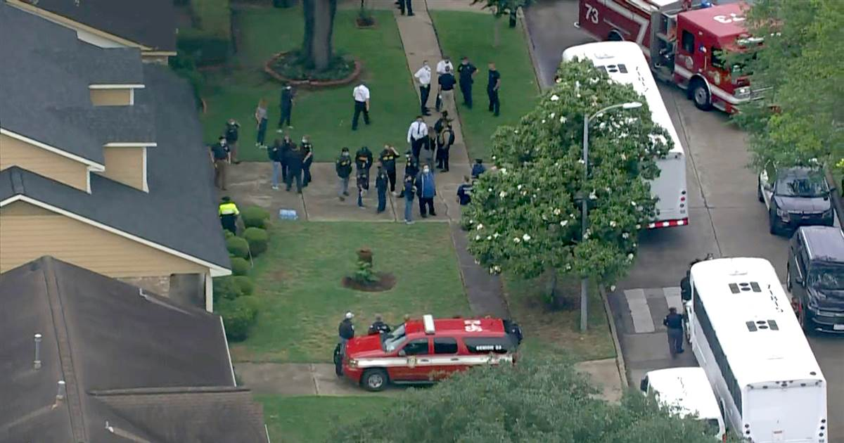 Five charged after almost 100 people found in Houston home in alleged smuggling operation