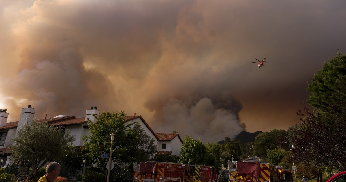 Brushfire threatens homes in Los Angeles' Pacific Palisades; arson suspected