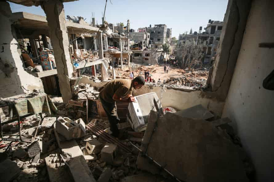 A Palestinian views the damage at his home in Beit Hanoun, Gaza
