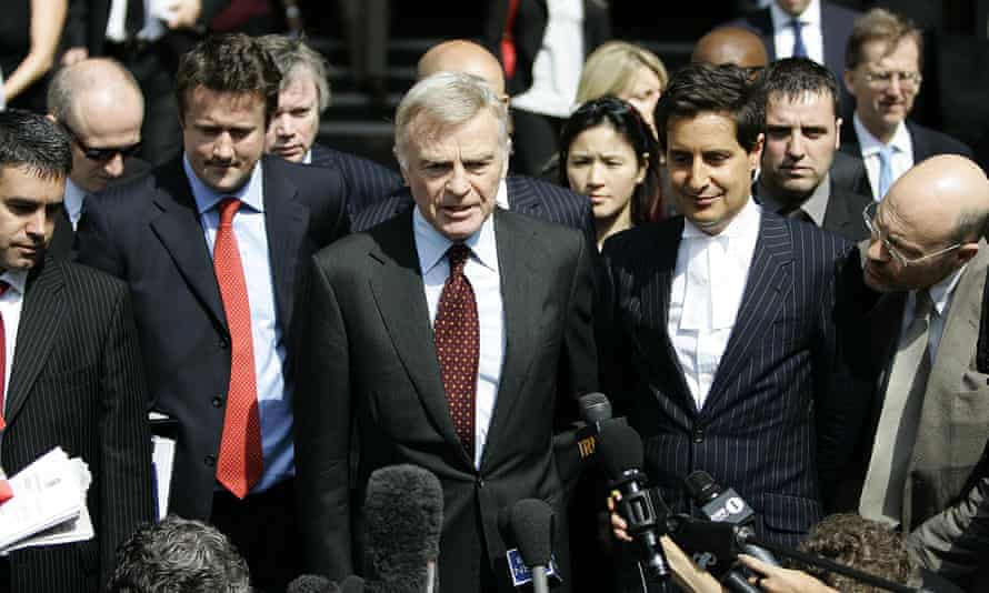 Max Mosley (centre) speaks to the press after winning his case against the News of the World in 2008.