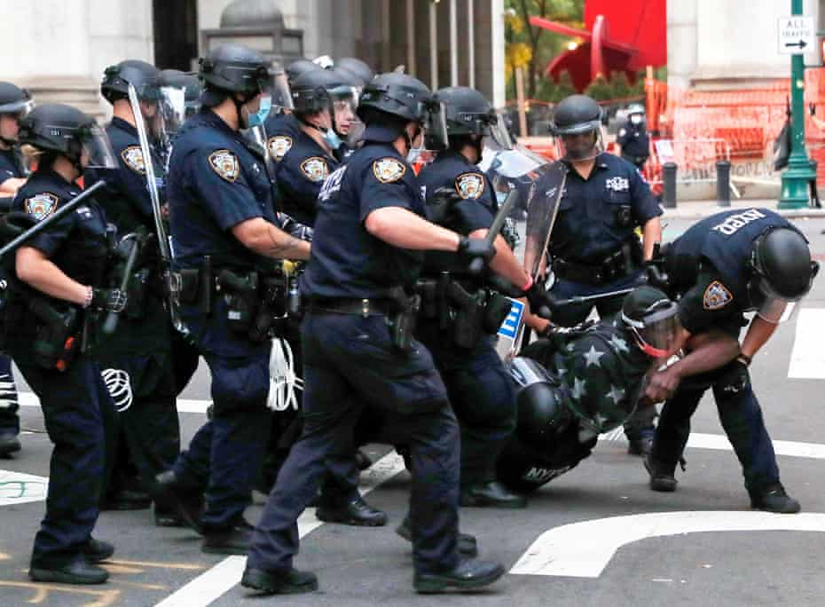 NYPD officers detain a demonstrator in July last year.