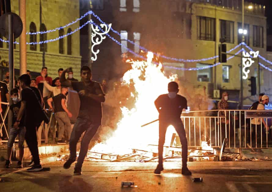 Palestinian protesters hurl stones at Israeli security forces amid clashes in Jerusalem's Old City on the night of Laylat al-Qadr.