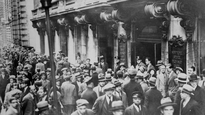 People gather outside the New York Stock Exchange on October 29, 1929, checking out the hysterical drop in stock prices.