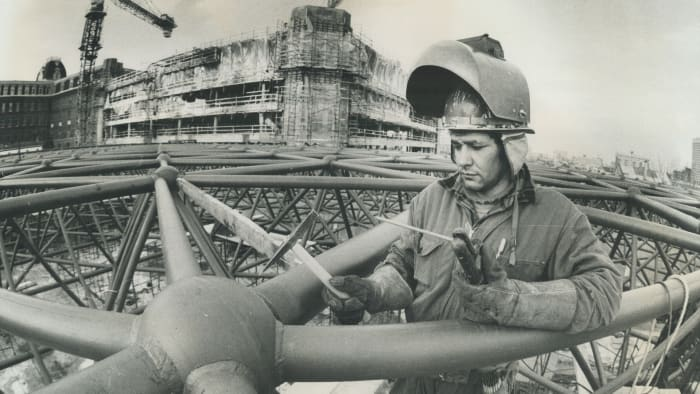 Undated photograph of Robert McComber, from the Caughnawaga Indian Reservoir, working on a steel construction site in downtown Montreal as a welder.
