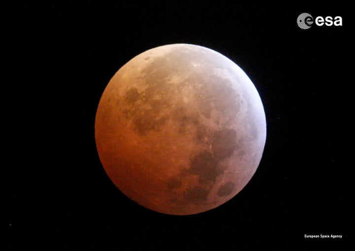 Image of the moon cast in a red-orange tint during a previous lunar eclipse in 2019.