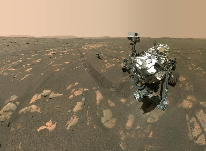 NASA's Perseverance Mars rover took a selfie with the Ingenuity helicopter, seen here about 13 feet (3.9 meters) from the rover. This image was taken by the WASTON camera on the rover's robotic arm on April 6, 2021, the 46th Martian day, or sol, of the mission.