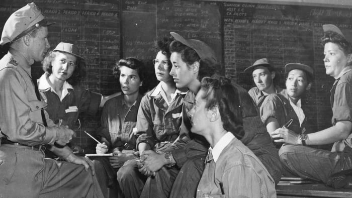 Group Commander Charles Sproul briefs a group of Women Air Force Service Pilots (WASP) at Avenger Field in Sweetwater, Texas, May 1943. Pictured, front, left to right: Sproul, Irma Cleveland, Faith Buchner, Martha Lundy, Mary Jane Stevens, and Annabelle Kekic;  back row, left to right: interns Ruby Mullins, Hazel Ying Lee and Virginia Harris Mullins.