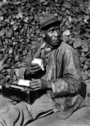 Coal worker in the Oak Ridge Coal Yard in Tennessee, 1945. The town of Oak Ridge was built by the Army Corps of Engineers on isolated farmland in 1942 as part of the Manhattan Project.
