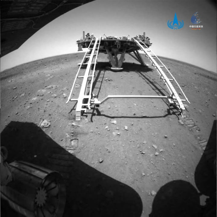 The view from the Zhurong rover as it deploys from its lander.