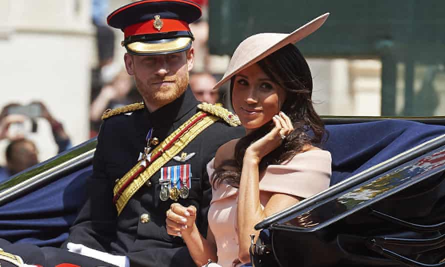 The Duke and Duchess of Sussex in a horse-drawn carriage after attending the Queen's Birthday Parade in 2018.