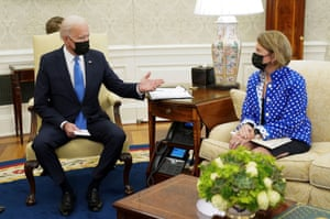 Joe Biden gestures toward Senator Shelley Moore Capito during an infrastructure meeting at the White House.