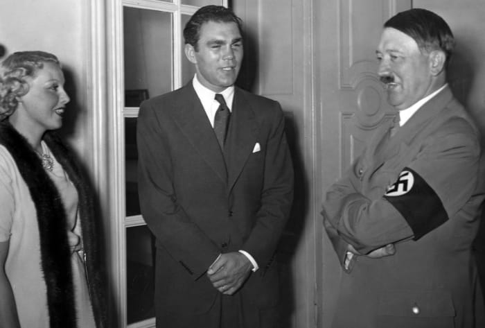 Adolf Hitler pictured with German boxer Max Schmeling and his wife Anny Ondra at the Reich Chancellery in Berlin after Schmeling's victory over Joe Louis in New York, 1936.