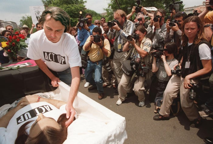 AIDS activist Wayne Turner strokes the hair of his late partner Steve Michael during a protest outside the White House in Washington, DC on June 4, 1998. Protesters mourn the death of ACT UP founder Michael in Washington , DC, died of AIDS on May 25, 1998.