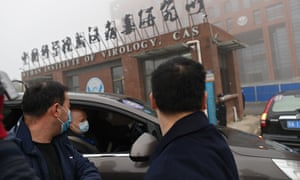 WHO staff arriving at the Wuhan Institute of Virology in February