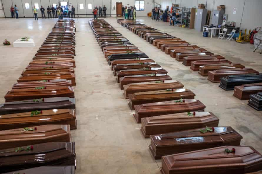 The coffins of the shipwrecked of the 3 October 2013 at the hangar of the airport of Lampedusa